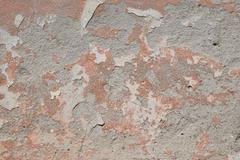 Old pink painted plaster gray peeling wall Stock Photos