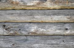 Old antique unpainted wooden logs wall texture Stock Photos