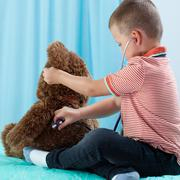 Child playing at doctor - stock photo