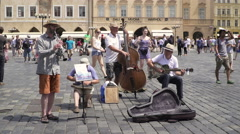 A street jazz band playing music in a Old Town Square in Prague Stock Footage