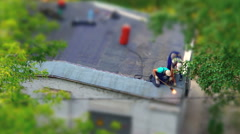 Workers heating and melting of bitumen roll during roof repair Stock Footage