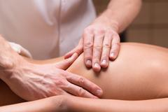 Massage for back pain relief - stock photo