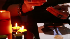 Woman holds a ritual of black magic. spell men. she uses photography. Stock Footage