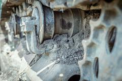 Aged abandoned industrial machine with corroded dirt stained caterpillar trac Stock Photos