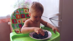 Child eating ripe berries Stock Footage