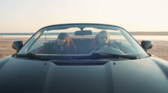 Happy young couple driving cabriolet during sunset Arkistovideo