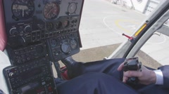 View at pilot hold control handle of helicopter. Camera inside. Pilot cabin Stock Footage