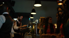 4K Friendly bar staff serving drinks to female friends partying in city bar Stock Footage