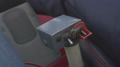 View at pilot hand on control lever of flying helicopter. Camera inside. Pilot Stock Footage
