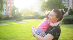 Mother and child are hugging and having fun outdoor in nature, Happy cheerful - stock footage