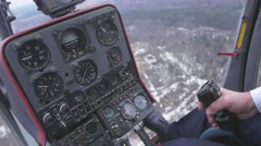 View at control system, pilot hold lever of helicopter. Camera inside. Pilot - stock footage