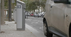 Electric car at power supply station in the city Stock Footage