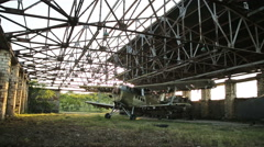Old military airplane in the hangar Stock Footage