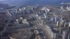 Aerial view from flying helicopter. Camera inside. Landscape of city at coast - stock footage