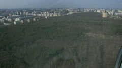 Aerial view from flying helicopter. Camera inside. Landscape of city, huge green - stock footage