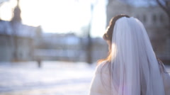 Bride in stylish serenity dress walk away and turn her head Stock Footage