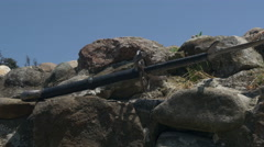 Sword on stones wall of medieval fortress,dolly shot on right,close up,low angle Stock Footage