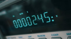 On the display of the electronic device is changing digits - stock footage
