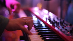 close up shot: Man musician playing electric piano on stage at a concert - stock footage