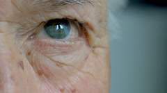 old man eye closeup outdoor portrait: pensive old man's eyes - stock footage