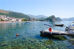 Pleasure boats on waterfront of resort town of Petrovac, Montenegro Stock Photos