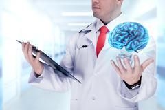 Doctor holding human organs and tablet in a hospital . High resolution. Stock Photos