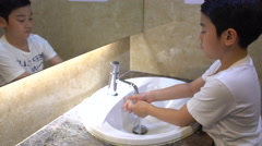 4k, Little asian boy washing hand in seven step with smiling face Stock Footage