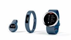 Fitness trackers on white Stock Footage