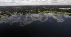Aerial of Windermere Florida viewing Water on Cloudy Day Stock Footage
