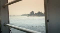 POV from cruise ship on the Nile through railings Stock Footage