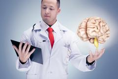 Doctor holding human organs and tablet on grey background . High resolution. Stock Photos
