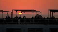 Silhouette of cruise ship on the Nile at sunset Stock Footage