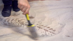 4k, Young Asian boy playing in the sandbox at dinosaurs museum Stock Footage