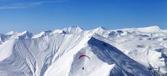 Panoramic view on sky gliding in high mountains - stock photo