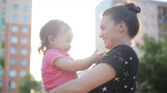 Beautiful Mother And Daughter outdoors. Beautiful Mum and her Child playing in Stock Footage