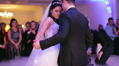 Beautiful bride and handsome groom dancing first dance at the wedding party Stock Footage