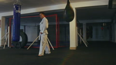 Sportsman training legs with punching bag in the gym. Slowly - stock footage