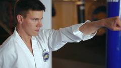Taekwondo. Movements training by young sportsman - stock footage