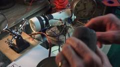 Fanatic bomb builder, detonator installed Stock Footage
