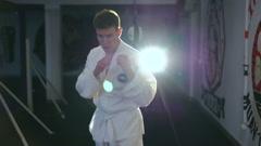 Taekwondo art by handsome sportsman, backlit - stock footage