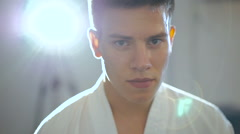 Close up portrait of handsome master of taekwondo with back light - stock footage