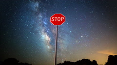 Astro Time Lapse of Milky Way over Stop Sign in Nevada Desert -Tilt Up- Stock Footage