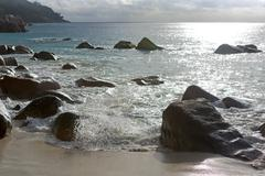 Rough waves at Anse Lazio, Praslin island, Seychelles - stock photo