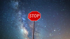 Astro Time Lapse of Milky Way over Stop Sign in Nevada Desert -Zoom Out- Stock Footage