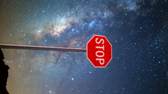 Astro Time Lapse of Milky Way over Stop Sign in Nevada Desert -Vertical Shot- Arkistovideo