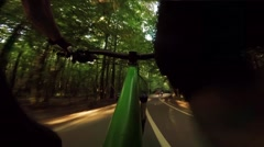 Mountain biking down hill. View from biker Stock Footage
