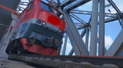 The train goes over a bridge across the river. Slow mo, slo mo Stock Footage
