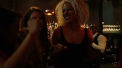 4K Bar staff & party crowd dancing & enjoying the atmosphere in lively nightclub Stock Footage