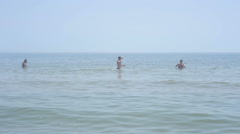 Guys bathe in the sea and playing with a ball - stock footage