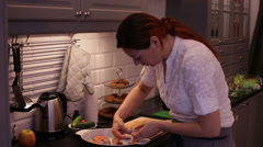 Woman Prepares Red Fish Salmon in the Kitchen Stock Footage